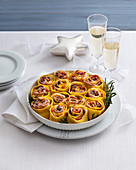 Gratinated lasagne rolls with porcini mushrooms and bacon