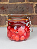 Pickled radishes in a flip-top jar