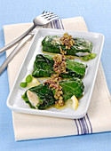 Hake and lettuce rolls with olive pesto