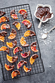 Candied blood oranges dipped in chocolate and sprinkled with finger salt