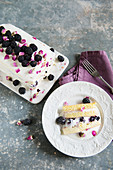 Creamy ice cream with blackberries and rose petals
