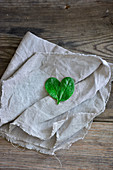 A spinach-leaf heart on a cloth