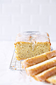 Moist poppyseed and lemon cake with icing, sliced