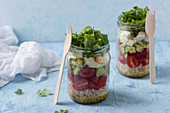 Salads in a jar with grains, vegetables and boiled egg