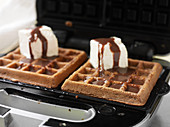 Waffles with marshmallows and chocolate sauce