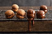 Chocolate macaroons coated in chocolate
