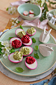 Stuffed Easter eggs on a wooden table flowers bunnies