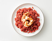 Beetroot risotto with prawns
