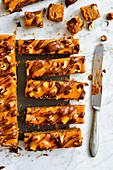 Cake in the form of bars with caramel nuts and chocolate