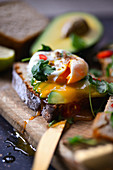 Poached egg flowing yolk toast avocado