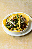 Fiery bean tacos with jalapenos and feta cheese