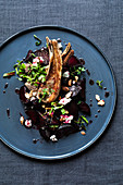 Caramelised, oven-roasted beetroot with a lamb chop and goat's cream cheese