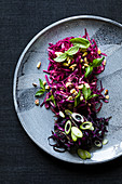 Vegan red cabbage salad with a trio of dressing