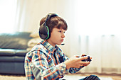 Young boy playing video game