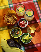 Tortilla chips, guacamole, salsa and drinks (Mexico)