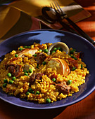 Paella with fish, mussels and peas