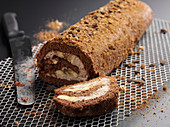 Chocolate biscuit roulade with pear cream