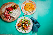 Milanese risotto, grilled peach salad and prosciutto with gorgonzola