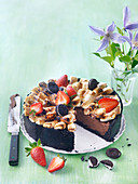 Chocolate cake with strawberries, grilled marshmallows and oreos