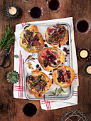 Small focaccias with figs, olives, walnuts, ham, onion, rosemary and cheese