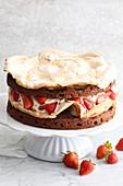 Chocolate and strawberry meringue cake