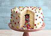 A pinata cake filled with colourful chocolate beans
