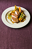 Duck breast in malt beer butter with oven-roasted pumpkin and pumpkin seed brittle