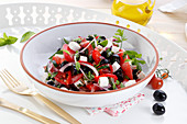 Summer salad with feta cheese, tomatoes and olives