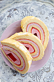 Sponge roll roulade with jelly and raspberry foam