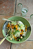 Turkish white cabbage and kohlrabi salad with pears, apricots and barberries