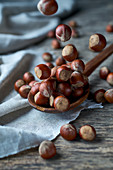 Hazelnuts on a wooden spoon