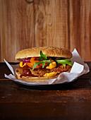 Burger with tomato, arugula and ketchup