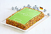 A football pitch cake with sugar sprinkles