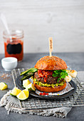 Burger with avocado and spring onions
