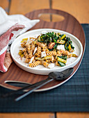 Spelt fusilli with a red lentil sauce and chard