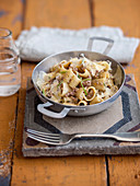 Pasta in a creamy minced meat sauce with shaved cheese