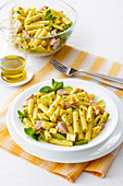 Pasta salad with tuna fish, omelette and avocado