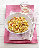 Gnocchi carrati (durum wheat gnocchi with a bacon sauce, Italy)