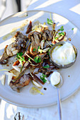Fried porcini mushrooms with dates and green almonds (Turkey)