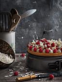 Sponge cake with fresh raspberries and coconut shavings