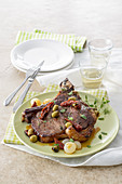 Rump steak with dried tomatoes and olives
