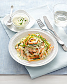 Carrot and courgette noodles with a turmeric and yoghurt sauce