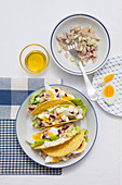 Tacos with tuna, egg, cucumber and a tuna and peppermint sauce