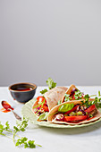 Wholemeal tortillas with aubergines and pico de gallo
