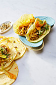 Saffron tortillas with onion and lentil cream, courgette and courgette flowers