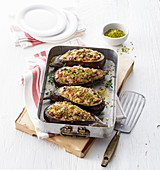 Aubergines in a spicy turkey and ham filling and pistachios