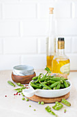 Fresh pea pods in a bowl