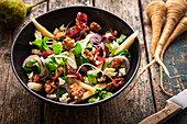 Winter salad with raw parsnips and walnuts