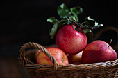 Red apples in a wicker basket