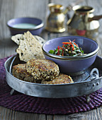 Lamb kebabs with mint sauce and lentil salad